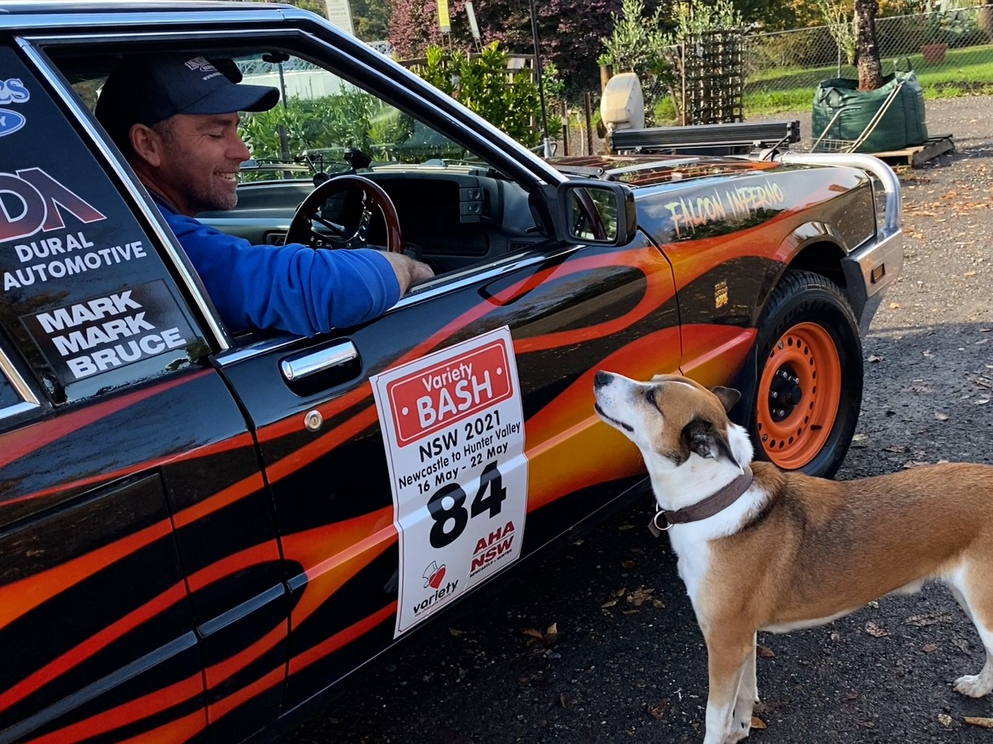 Mark Engall farewells his dog Reggie before taking part in the 2021 Variety Bash